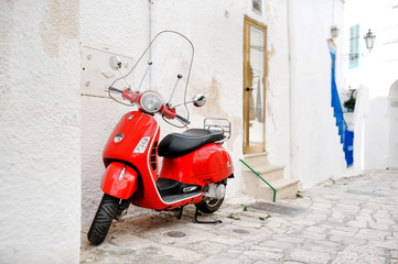 italian scooter red vespa in a alley, Ostuni, Apulia, Italy