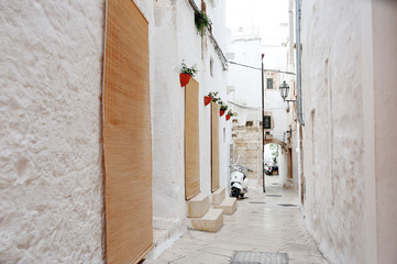 alleyway in medieval city of Ostuni, Apulia, Italy