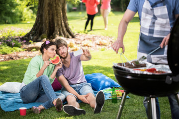 Taking selfie during barbecue