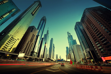 Fotomurales -  Sheikh Zayed Road in sunset time, Dubai, UAE