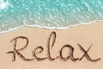 Wall Murals Relaxation Word Relax is hand written on sand