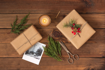 Christmas gifts on rustic wooden background