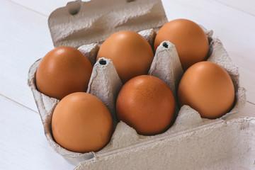 Fresh organic eggs in a carton