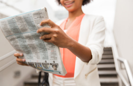 close up of african woman reading newspaper