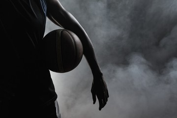 Closeup of a man holding a basketball