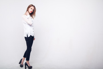 Contemporary Clothing Design. Modish Woman in White Blouse and Pants. Fashion