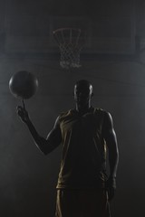 Basketball player turning the ball on his finger