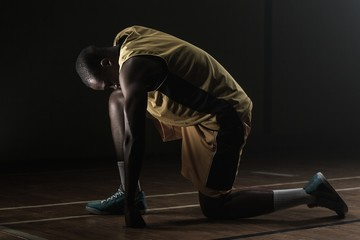 Basketball player preparing to play with knee