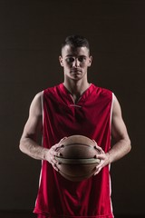 Portrait of basketball player holding a ball