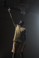 Basketball player pointing up with his finger