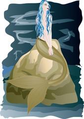 Beautiful  mermaid sitting on rock by the sea