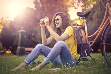 Girl taking a picture in the park
