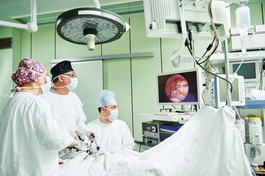 surgeons team hands during laparoscopic abdominal operation in child surgery