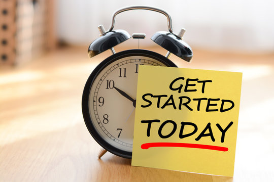 Start today your own business concept with alarm clock and post it message