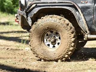 4x4 vehicle with tires full of mud to an off-road competition
