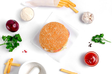 Burger topped with vegetables, spices and fries