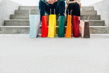 Couple with colorful shopping bags