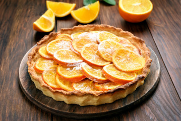 Pie with orange caramelized slices