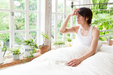 portrait of young asian man in the bed