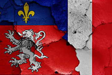 flags of Lyon and France painted on cracked wall