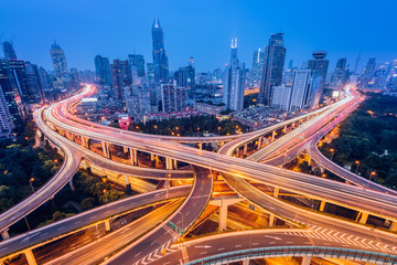 Spoed Foto op Canvas Nacht snelweg Aerial view of a highway overpass at night in Shanghai - China.