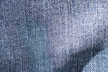 Blue denim texture and background close up