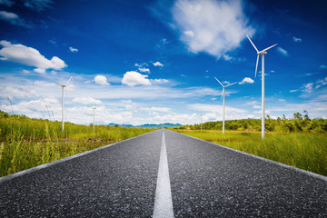 eco road concept with turbines and green field