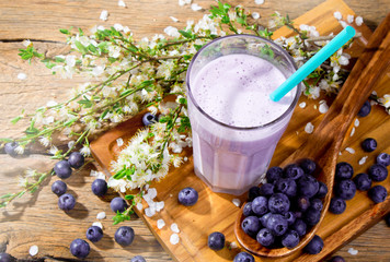 Fresh milk, blueberry drink on wooden table, assorted protein cocktail with fresh fruits.