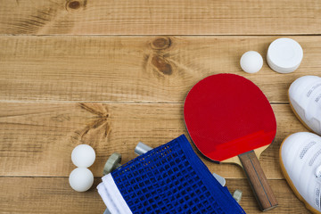 Table tennis equipment on wooden texture background with copy space