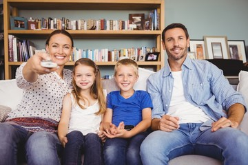 Smiling family watching television