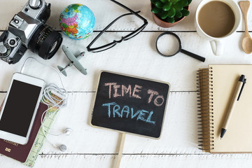 Outfit of traveler on white wooden background and copy space