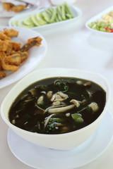 Mushroom curry with herb juice in white bowl, Thai food, Esan st