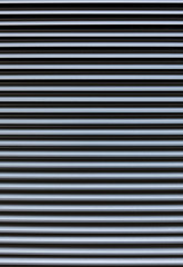 rows of metal silver bar, background, textured