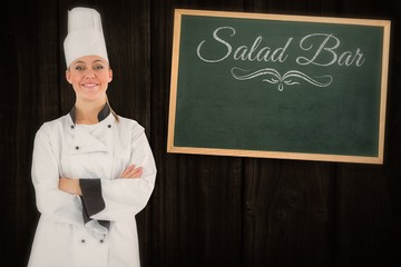 Composite image of friendly woman chef smiling and crossed arms