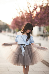 Young Asians girl with modern dress posing in an old Krakow