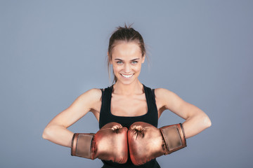 Beautiful sports girl with boxing gloves