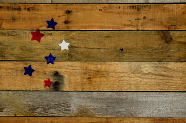 Red, white and blue stars on rustic decorative pallet wood background, backdrop. USA Holiday, Memorial Day, Veteran's Day, 4th of July, Labor Day, President's Day