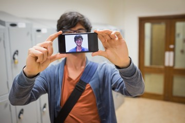 Student taking his selfie on smartphone