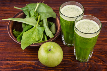 Healthy spinach smoothie and apple  on wooden rustic background