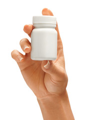 Woman's hand holding bottle for pills isolated on white background. Palm up, close up. High resolution product.