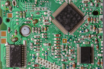 Close-up shot of an old and used integrated circuit board