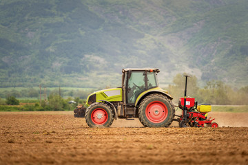 Fototapete - Tractor spraying wheat field with sprayer, herbicides and pestic