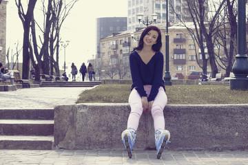 Girl posing wearing a roller skates.