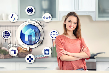 Smart home control concept. Young woman in kitchen