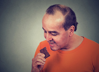man tired of diet restrictions craving sweets chocolate