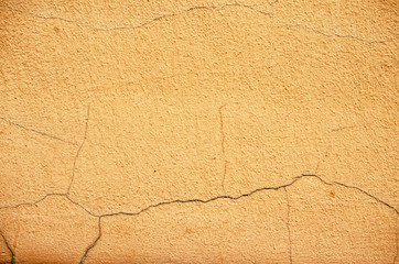 Old bright wall with cracked plaster.
