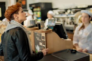 Bakery Item / Woman choosing bakery items in a shop