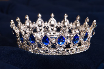 Royal crown with sapphires, luxury retro style.