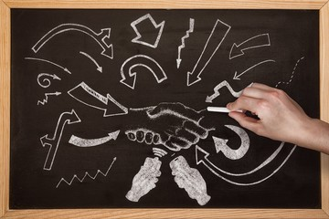 Composite image of hand writing with chalk
