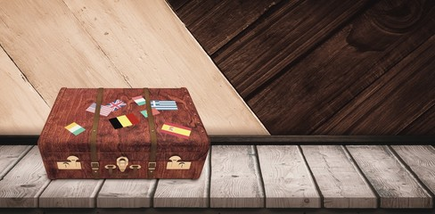 Composite image of suitcase with stickers